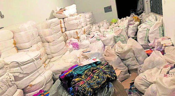 Sarees seized from a godown in Mysuru on Friday. (DH Photo)