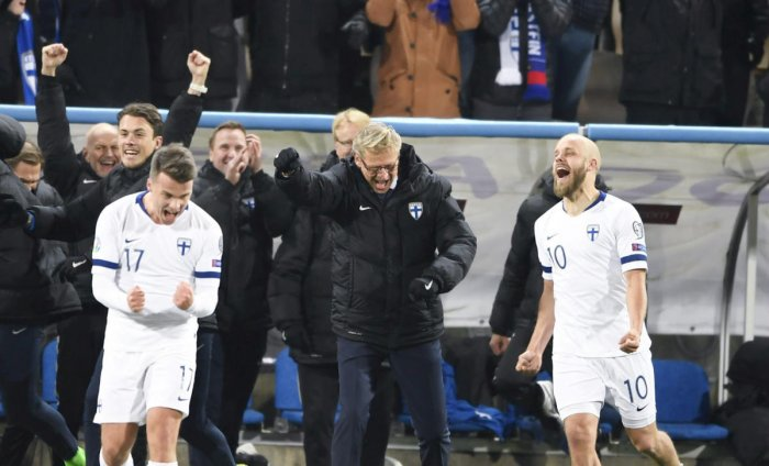 Simon Skrabb, head coach Markku Kanerva and Teemu Pukki of Finland celebrate. (Photo by REUTERS)
