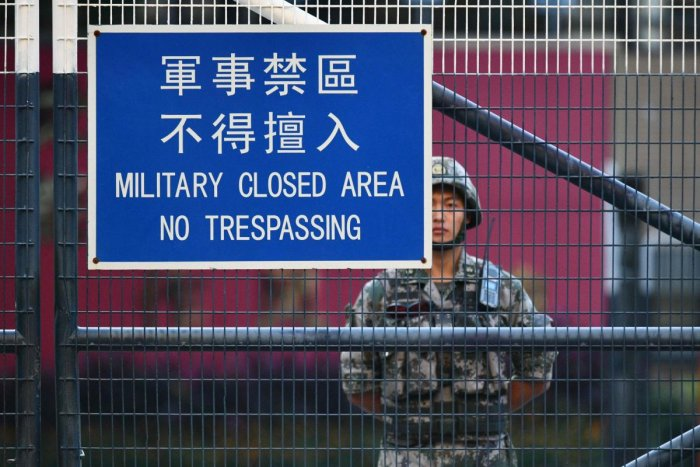 A member of China's People's Liberation Army (PLA) stands guard inside Osborn Barracks in Kowloon Tong in Hong Kong on November 16, 2019. (AFP)