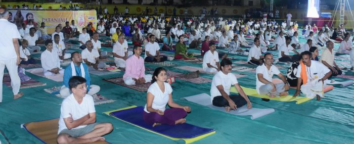 Yoga enthusiasts take part in the five-day Yoga camp organised by Paryaya Palimaru Mutt at parking area of the Sri Krishna Mutt in Udupi.