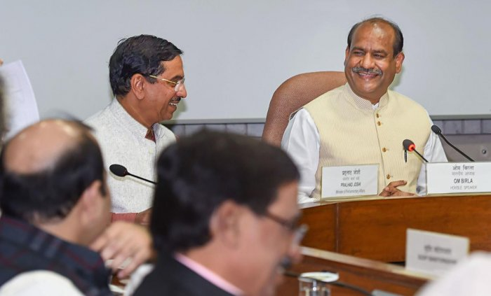 Lok Sabha Speaker Om Birla with Union Minister for Parliamentary Affairs Prahlad Joshi at an All-Party meeting, at Parliament House in New Delhi on Saturday. (PTI Photo)