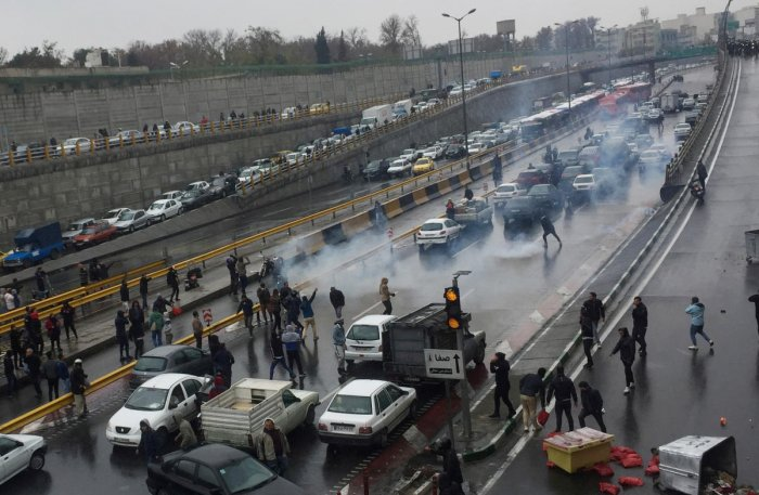 People protest against increased gas price, on a highway in Tehran, Iran November 16, 2019. (Nazanin Tabatabaee/WANA (West Asia News Agency) via REUTERS)