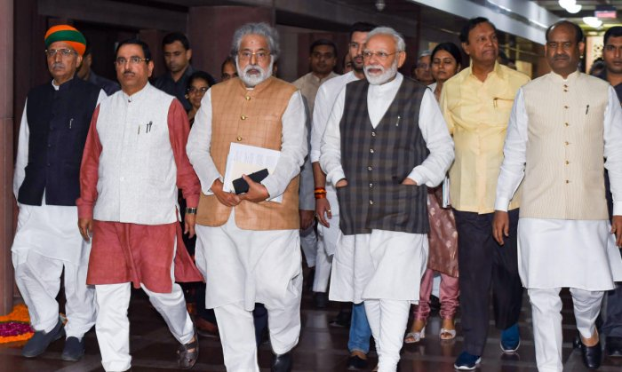 Prime Minister Narendra Modi with Lok Sabha Speaker Om Birla, Union Minister for Parliamentary Affairs Prahlad Joshi, MoS Parliamentary Affairs Arjun Ram Meghwal, TMC's Sudip Bandopadhyay and others leave after an All-Party meeting, at Parliament House in New Delhi. PTI