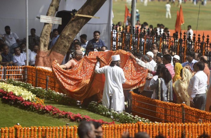 Shiv Sena party workers pay tribute at the memorial of Shiv Sena founder Balasaheb Thackeray on his 7th death anniversary in Mumbai on Sunday. (PTI Photo)