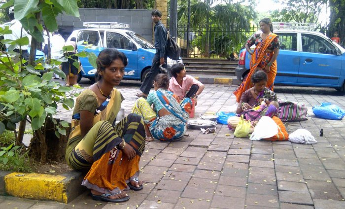 Pardhis living on the street off The Gateway of India, Mumbai