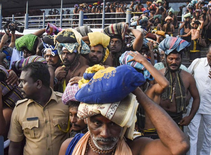 Devotees arrive at the Lord Ayyappa temple (PTI Photo)