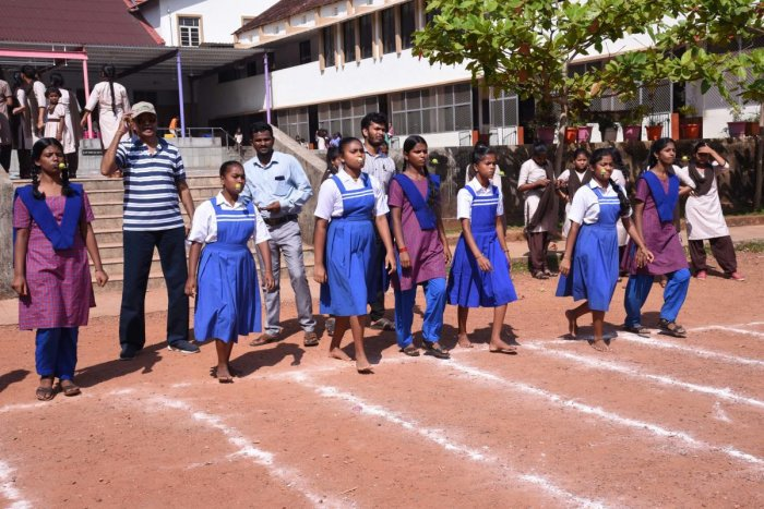 Children take part in the lemon and spoon race at the Orphanage Olympics organised by Rotary Club of Mangaluru Central and Rotaract Club at Canara High School, Urwa, in Mangaluru on Sunday.