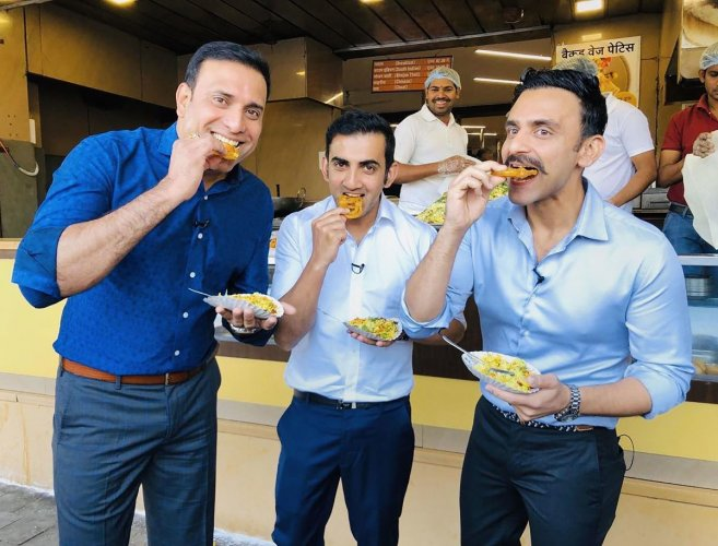 Photo posted on the official twitter account of former cricketer VVS Laxman on Friday, Nov. 15, 2019, shows Laxman, cricketer-turned-politician Gautam Gambhir and broadcaster Jatin Sapru eating 'Jalebis' and 'Pohe' for breakfast, in Indore, Saturday. (PTI Photo)