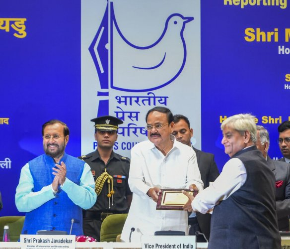 Vice President M Venkaiah Naidu presents 'Raja Ram Mohan Roy Award' to Rajasthan Patrika group chairman Gulab Kothari during the National Awards for Excellence in Journalism 2019, at Vigyan Bhavan in New Delhi. PTI