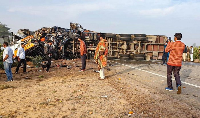 Mangled remains of a vehicle after a road accident at NH-11, in Bikaner. (PTI Photo)