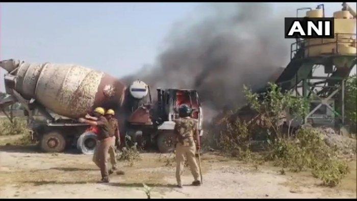 A vehicle of crusher plant was set ablaze on Sunday. (Twitte image/@ANINewsUP)