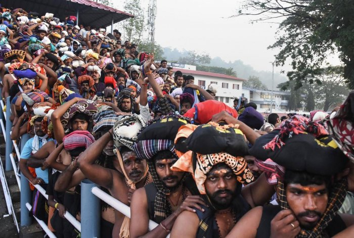 Devotees stand in queues to offer prayers at the Lord Ayyappa temple during the two-month long Mandala-Makaravillakku pilgrimage season, in Sabarimala. (PTI Photo)