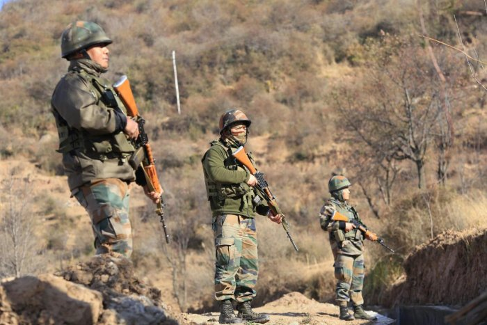Army jawans take positions along LoC in Rajouri. (photo by PTI)