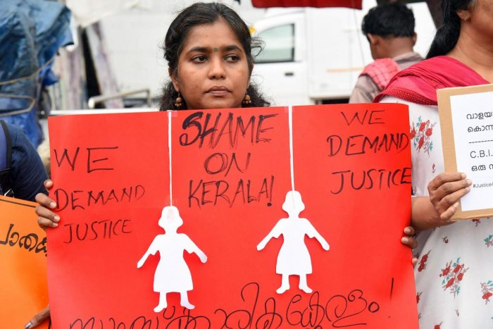 A woman protests against 'Walayar Sisters' case, in Kochi. (PTI Photo)
