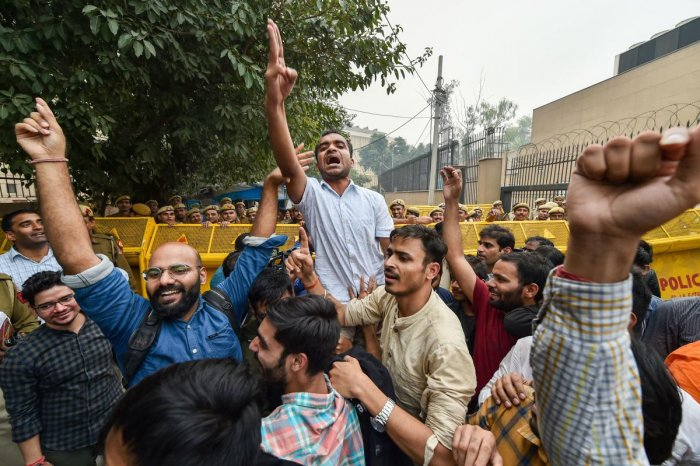 JNU students celebrate after partial roll-back in the fee hike by the University administration, at the UGC office at ITO in New Delhi, Wednesday, Nov. 13, 2019. (PTI Photo)