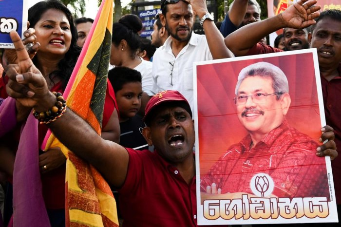 Supporters of Sri Lanka's President-elect Gotabaya Rajapaksa shout slogans as he leaves the election commission office in Colombo on November 17, 2019. AFP