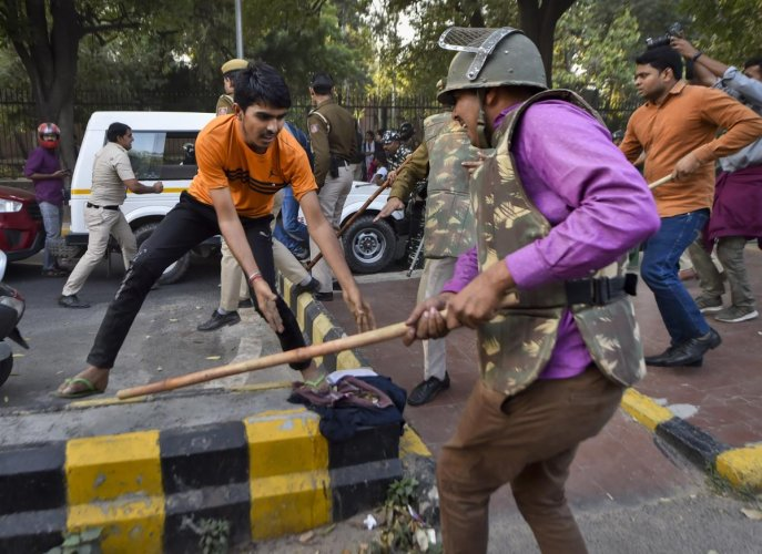 Jawaharlal Nehru University students are baton-charged by police during a protest march towards Parliament, on the first day of the Winter Session, demanding a total rollback of the hostel fee hike. (PTI Photo)