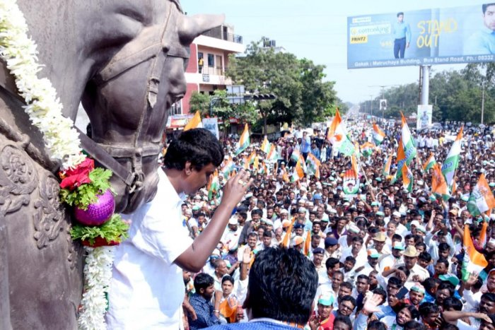 Congress candidate Lakhan Jarkiholi waves at his supporters while on his way to file nomination papers at Gokak in Belagavi district on Monday. DH photo