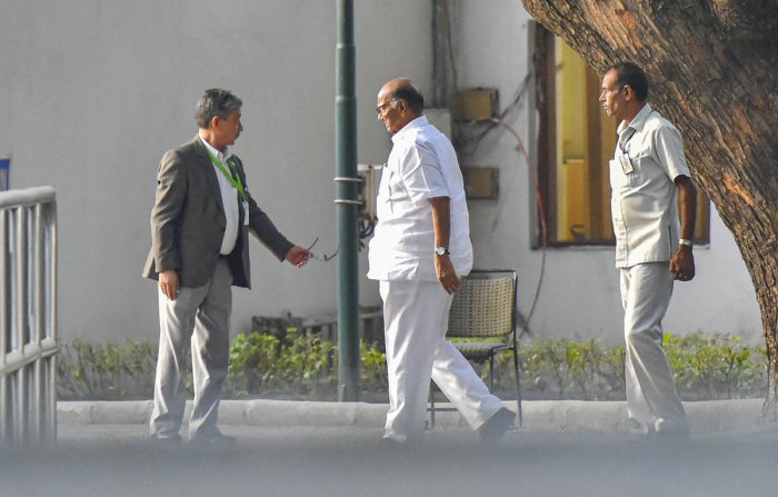 NCP chief Sharad Pawar arrives at the residence of Congress President Sonia Gandhi to discuss government formation in Maharashtra, in New Delhi.  (PTI Photo)