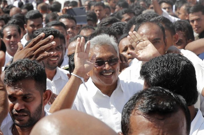 Sri Lanka's newly elected president Gotabaya Rajapaksa greets people as he leaves after taking the oath of office during the swearing in ceremony held at the 140 B.C Ruwanweli Seya Buddhist temple in ancient kingdom of Anuradhapura in northcentral Sri Lanka Monday, Nov. 18, 2019. (PTI Photo)