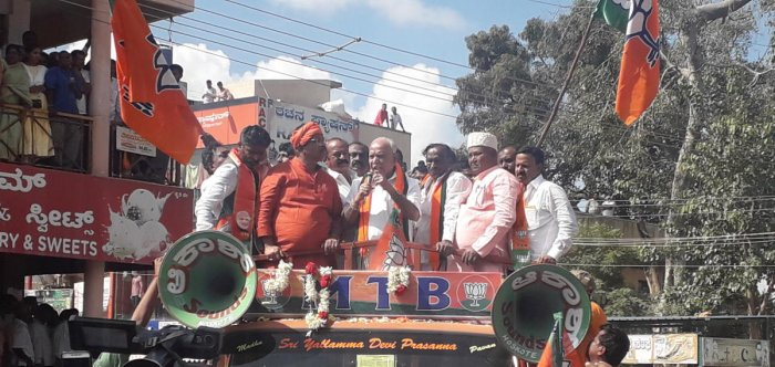 hief Minister B S Yediyurappa takes part in a procession taken out before BJP candidate M T B Nagaraj filed nomination papers from Hoskote on Monday. Nagaraj, Minister R Ashoka and party leader Katta Subramanya Naidu look on. DH photo