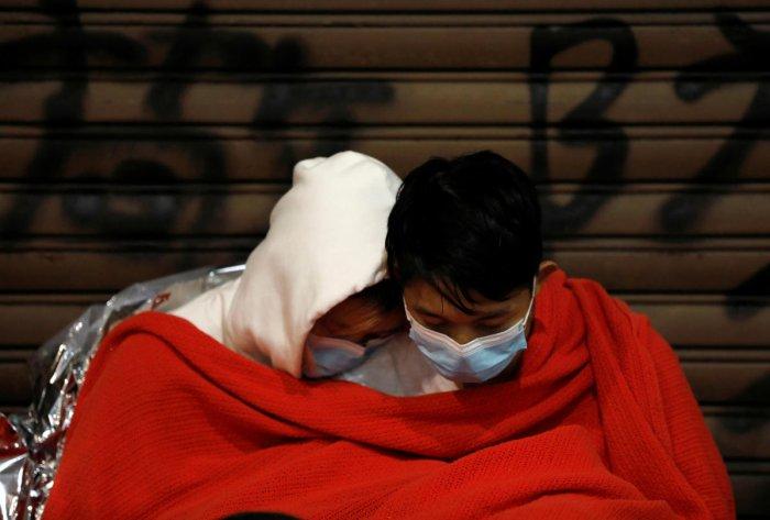Protesters sits inside the Hong Kong Polytechnic University campus while waiting for medical attention during protests in Hong Kong, China, November 19, 2019. REUTERS/Adnan Abidi
