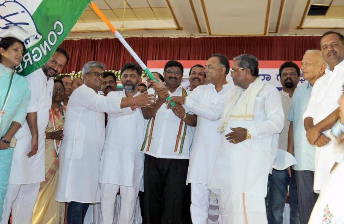 District Congress Committee former president Dr D L Vijay Kumar hands over the party flag to the new president Dr K P Amshumanth, during the installation ceremony, in Chikkamagaluru on Tuesday.