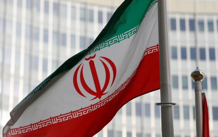 The Iranian flag flutters in front the International Atomic Energy Agency (IAEA) headquarters in Vienna. Photo/Reuters