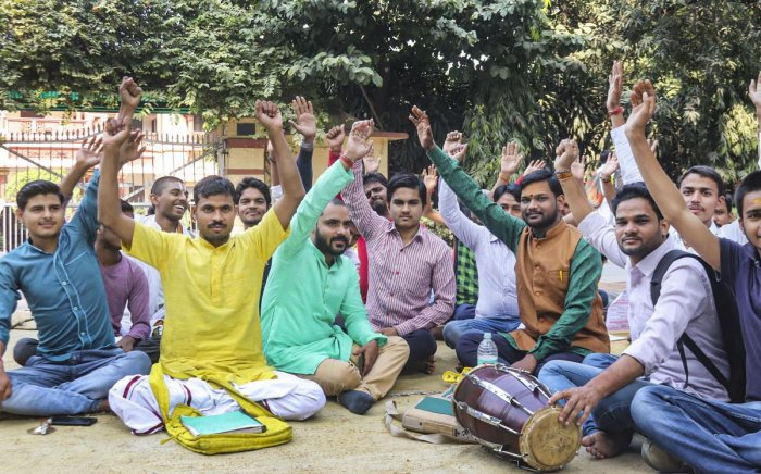 Students stage a protest dharna at the Banaras Hindu University (BHU) against the appointment of a Muslim teacher of Sanskrit at the universirty, in Varanasi, Wednesday, Nov. 20, 2019. (PTI Photo)