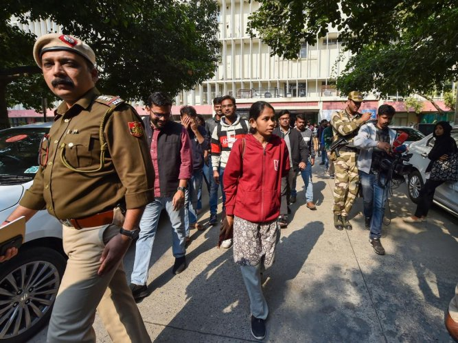awaharlal Nehru Students' Union (JNUSU) president Aishe Ghosh with other students comes out after meeting with Ministry of Human Resources Development (MHRD) officials at Shastri Bhawan. PTI