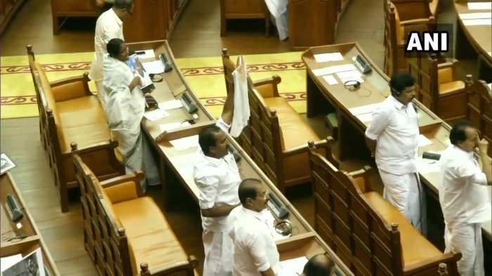 The Opposition, Congress-led United Democratic Front, on Wednesday disrupted proceedings of the Kerala Assembly by staging a strong protest against the police action against Congress MLA Shafi Parambil on Tuesday. (ANI photo)