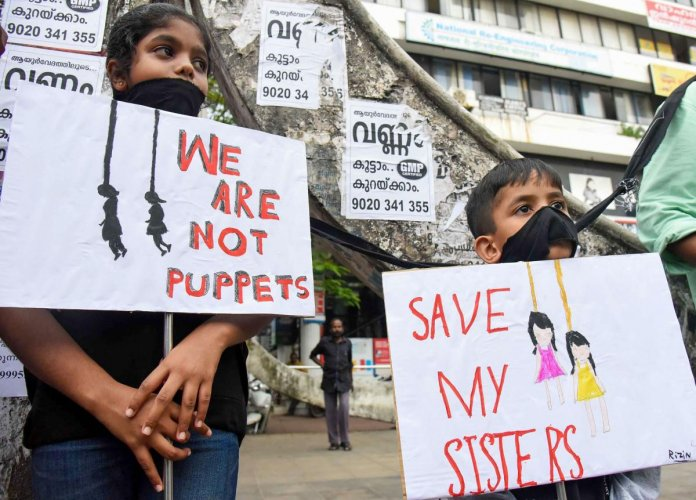 Children protest against 'Walayar Sisters' case, in Kochi. (PTI Photo)