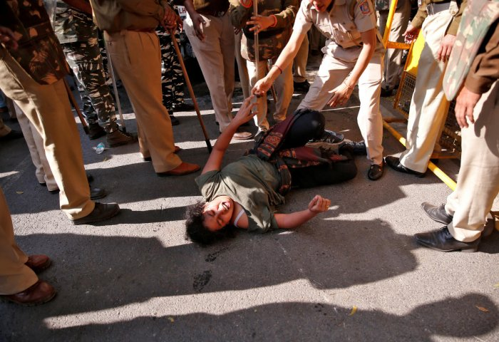 A student of Jawaharlal Nehru University (JNU) reacts as police try to detain her during a protest against a proposed fee hike, in New Delhi, India. (PTI Photo)