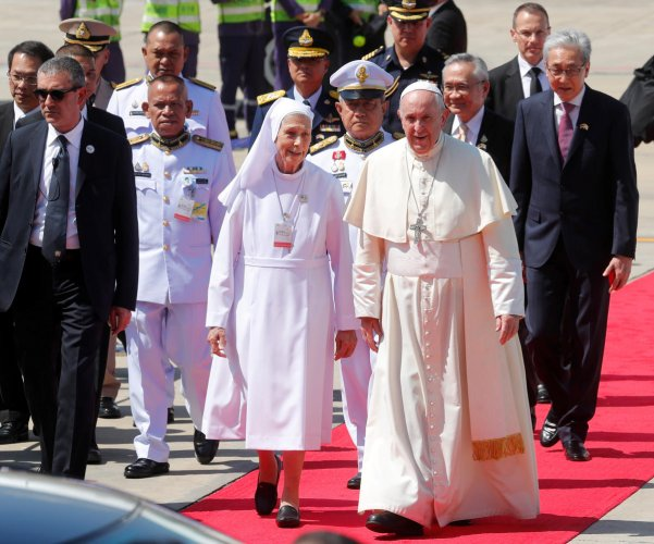 Pope Francis flanked by a Salesian nun Ana Rosa Sivori, who is his cousin, arrives at a military air terminal in Bangkok, Thailand November 20, 2019. (Photo by Reuters)