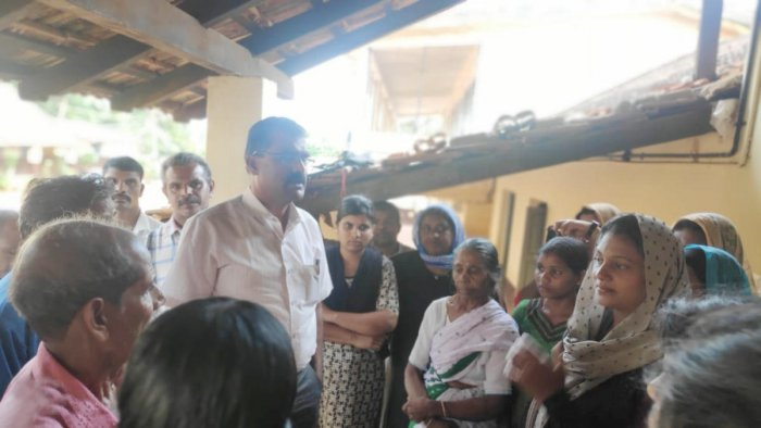 Assistant Commissioner Javaregowda interacts with the inmates of the relief centre in Nelyahudikeri on Wednesday.