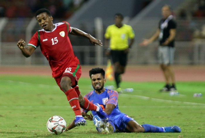 Oman's al-Mandhar al-Alwi (L) fights for the ball with India's Branon Fernandes during the FIFA World Cup 2022 and the 2023 AFC Asian Cup qualifying football match between Oman and India at the Sultan Qaboos Sports Complex. AFP