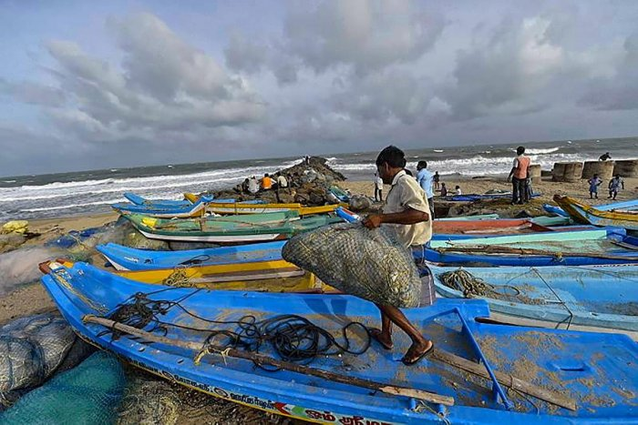 Chennai: Fishermen dock their boats as a precautionary measure ahead of the arrival of cyclone 'Gaja', in Chennai, Thursday, Nov. 15, 2018. Cyclone 'Gaja' intensified into a severe cyclonic storm and is expected to cross the south Tamil Nadu coast by late
