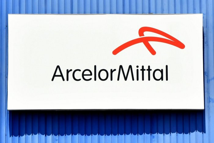The logo of the steel manufacturing giant Arcelor Mittal Italia. (Photo by AFP)