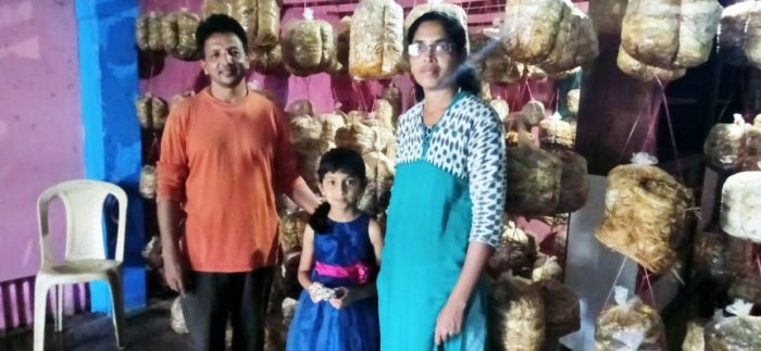 Francis D'Souza along with his family inside the room where mushroom is cultivated.