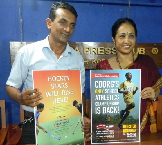 Former athlete and Ashwini Sports Foundation Director Ashwini Nachappa (right) releases the banner of the district-level track and field championship and Karumbaiah Memorial Masters' Cup in Madikeri on Tuesday.