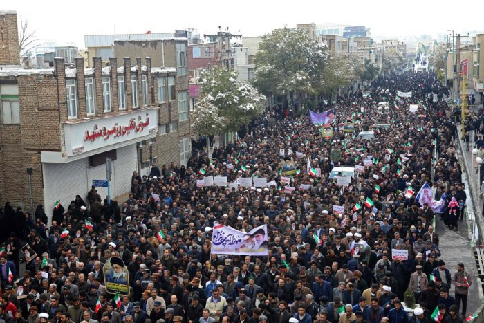 Iranians take to the streets in support of the Islamic republic's government and supreme leader, Ayatollah Ali Khamenei, in the central city of Arak, southwest of the capital Tehran, on November 20, 2019. (AFP Photo)