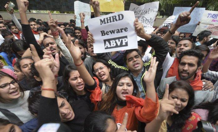 Jawaharlal Nehru University (JNU), Akhil Bharatiya Vidyarthi Parishad (ABVP) and Delhi University Students' Union (DUSU) students raise slogans during a protest march from Mandi House towards Jantar Mantar pressing for their demands. (PTI Photo)