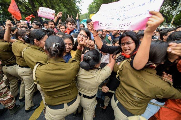 Jawaharlal Nehru University (JNU), Akhil Bharatiya Vidyarthi Parishad (ABVP) and Delhi University Students' Union (DUSU) students clash with police as they raise slogans during a protest march from Mandi House towards Jantar Mantar pressing for their dema