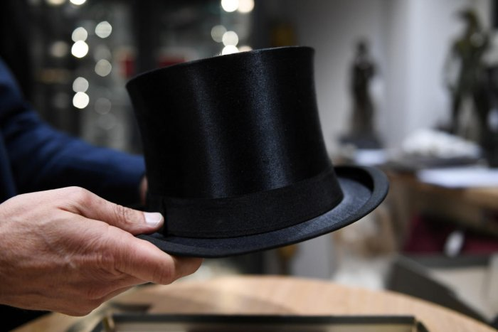 A man holds the cylinder hat of German Nazi leader Adolf Hitler at the auction house Hermann Historica in Munich (Reuters photo)