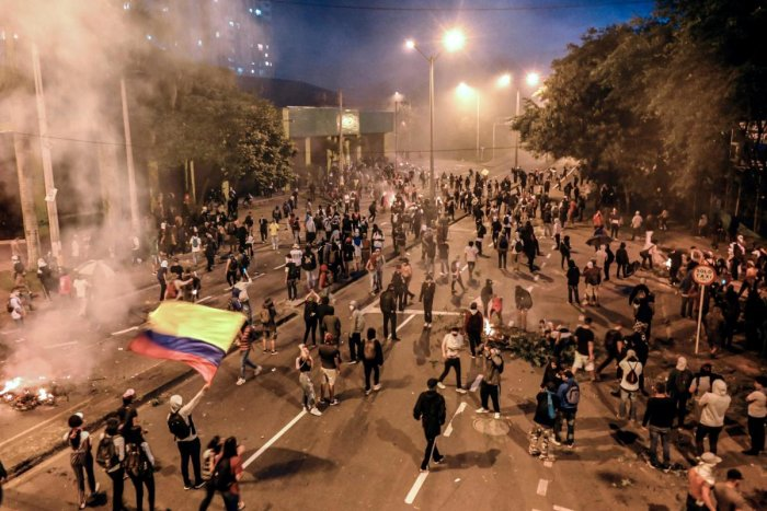 University students clash with members of the Mobile Anti-Disturbance Squadron (ESMAD), during a nationwide strike called by students, unions and indigenous groups to protest against the government of Colombia's President Ivan Duque in Medellin, Colombia. (AFP Photo)