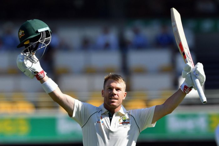 Australia's batsman David Warner celebrates reaching his century, 100 runs, on day two of the first Test cricket match between Pakistan and Australia at the Gabba in Brisbane on November 22, 2019. (Photo by Saeed KHAN / AFP)