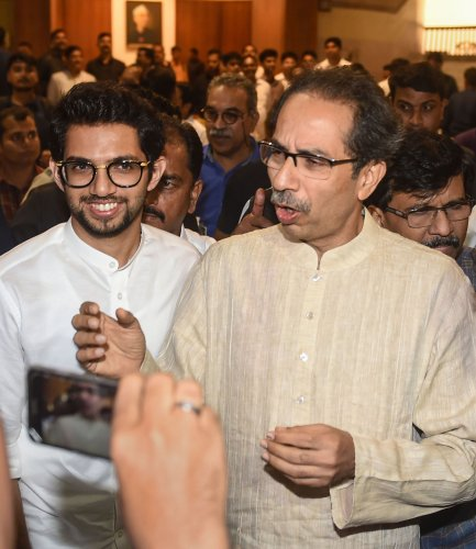 Shiv Sena chief Uddhav Thackeray and son Aaditya Thackeray leave after a meeting with Congress and NCP leaders, at Nehru Centre in Mumbai. (PTI Photo)