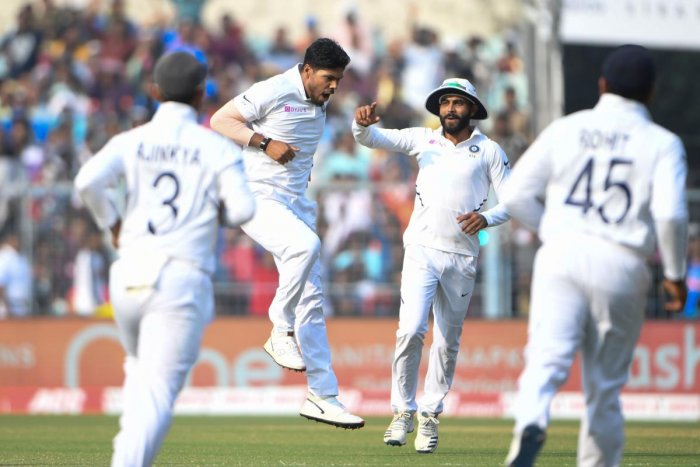 Umesh Yadav (2L) celebrates with teammates after dismissing Bangladesh's Shadman Islam (not pictured) during the first day of the second Test cricket match of a two-match series between India and Bangladesh at The Eden Gardens cricket stadium in Kolkata on November 22, 2019. (AFP)