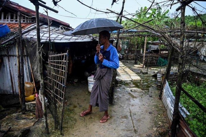 A man standing outside a house in Kyauktalone camp in Kyaukphyu, Rakhine (AFP photo)
