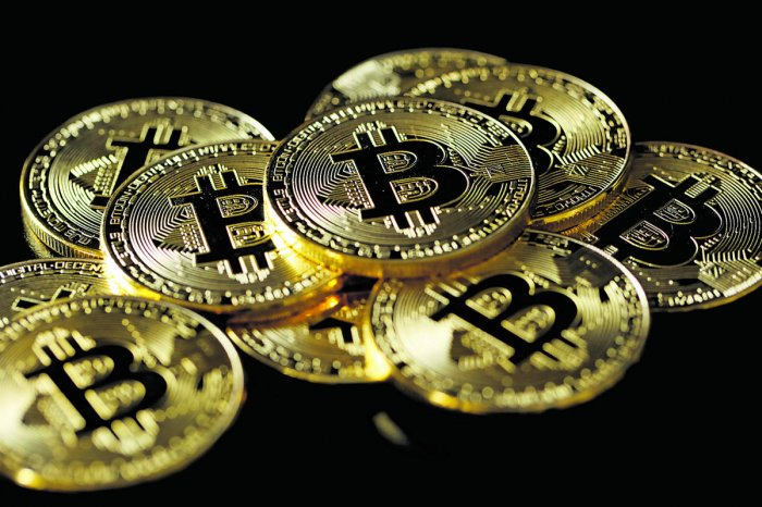 A collection of Bitcoin (virtual currency) tokens is displayed in this picture. (Reuters Photo)